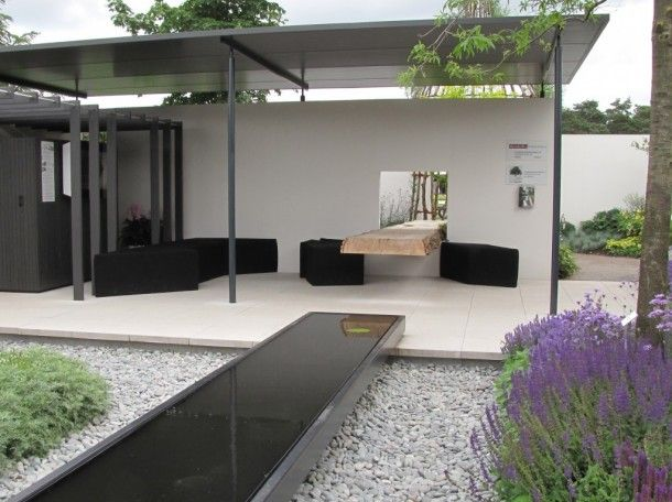 modern garden with water feature. love the window table