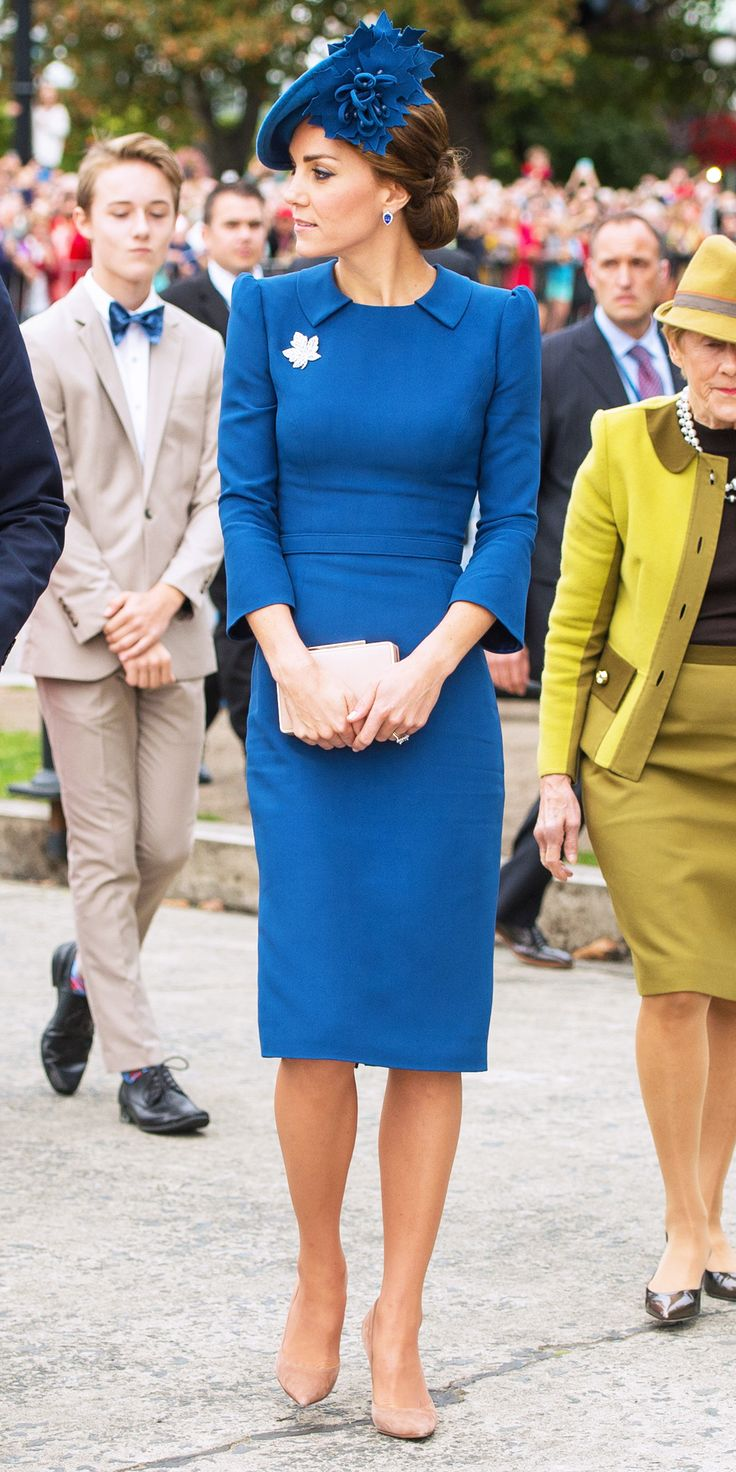 Middleton was the picture of elegance on the first day of her Canadian tour in a collared blue sheath dress and matching hat. The royal accessorized with a leaf brooch and nude pumps that elongated her frame.