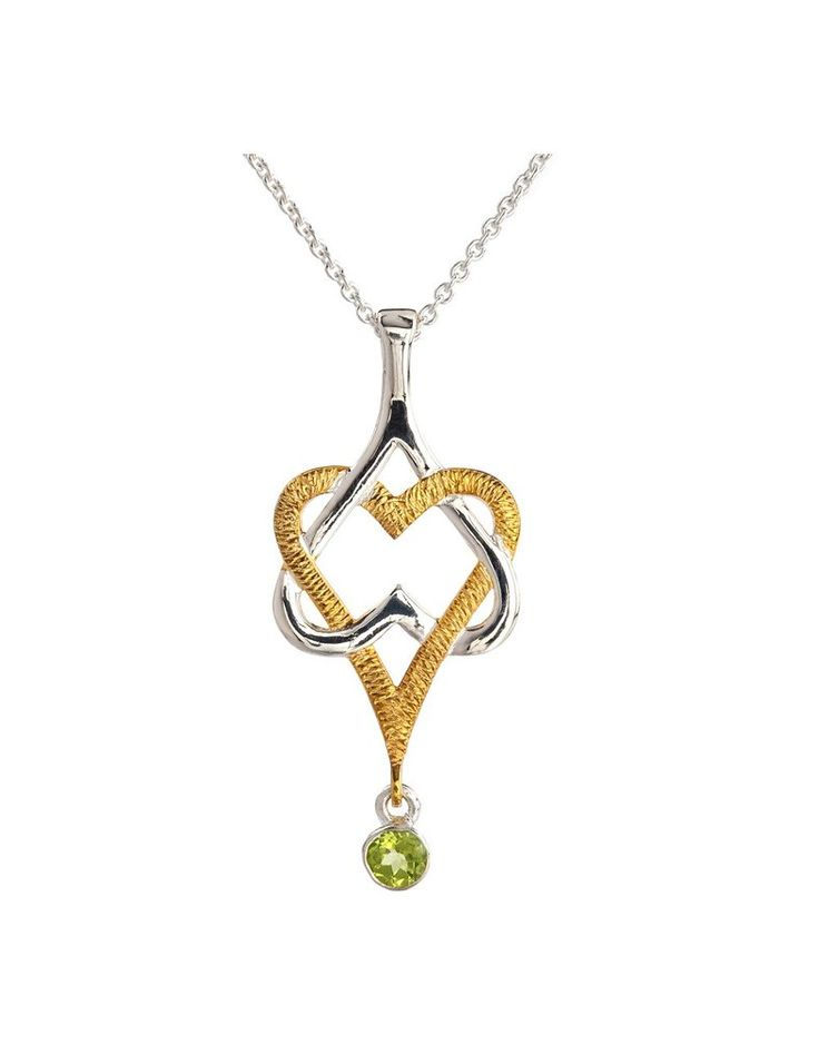 """This pendant is representative of the Irish term, """"Mo Chroi"""" meaning """"my love"""" or """"my darling"""". It features two interlocking hearts with a beautiful Irish green gem. The Irish pendant measures approximately 1 ¾"""" tall by ¾"""" wide and is crafted from sterling silver and 22ct gold vermeil for contrasting hearts! It also features a manmade peridot gemstone. The pendant hangs from an 18"""" long sterling silver chain and comes beautifully gift boxed with a story card making it a perfect Irish gift!"""