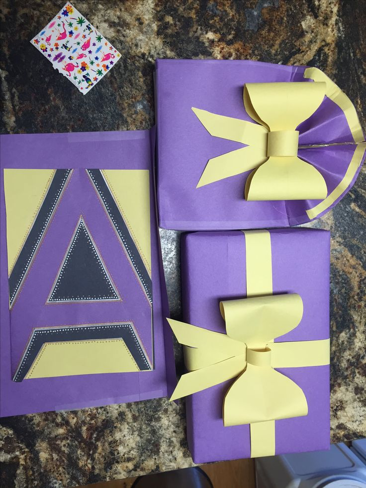 Fancy gift wrapping with construction paper :)