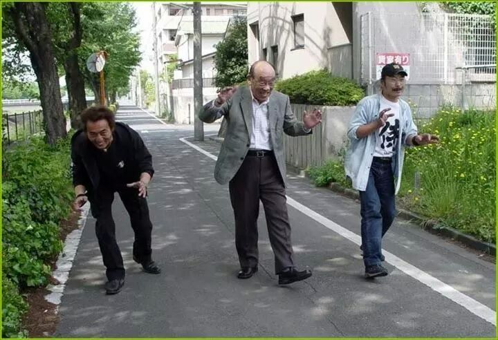 All 3 generations of godzilla suit wearers walking down the street together. - Imgur