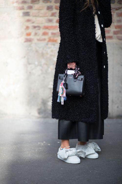 Carlotta Oddi wearingJoshua Sanders bow sneakers and Saint Laurent bag.
