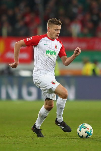 Alfred Finnbogason of Augsburg runs with the ball during the Bundesliga match between FC Augsburg and VfL Wolfsburg at WWK-Arena on November 25, 2017 in Augsburg, Germany.