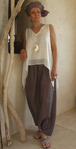 Top made of  white silk veil worn over a purple shantung harem pants