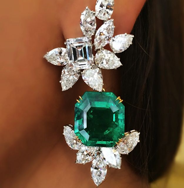 Harry Winston - Emerald and Diamond Earring - Each octagonal step-cut emerald detachable drop, to the pear and marquise-cut diamond cluster base, and rectangular-cut diamond surmount, weighing approximately 3.01 and 3.02 carats, within a pear and marquise-cut diamond cluster surround, 6.0 cm, mounted in platinum and gold. With maker's mark of Jacques Timey for Harry Winston.