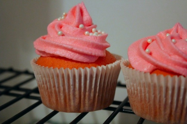 Raspberry pink champagne cupcakes. Just made these. Ate three. Think they're a hit.