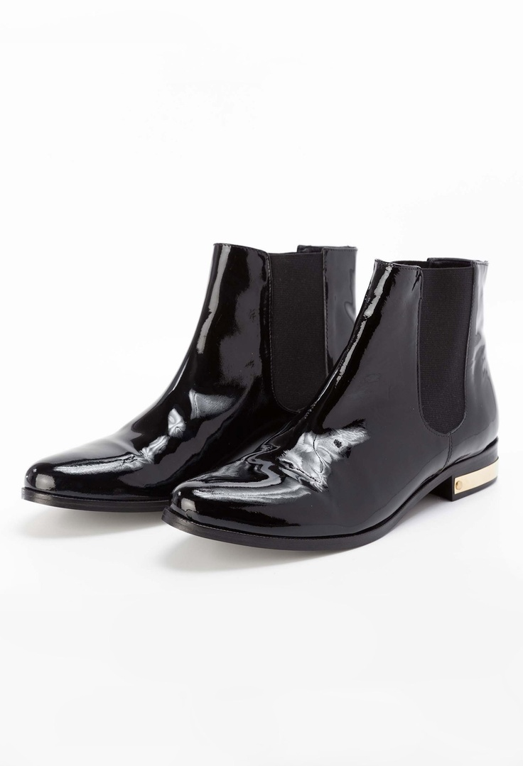 Black patent leather boots by Claudie Pierlot