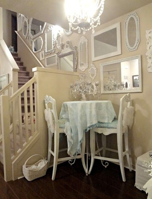White, shabby chic decor. Personally, I would add a few more touches of color ~ but, overall I love the idea! love the mirrors!: