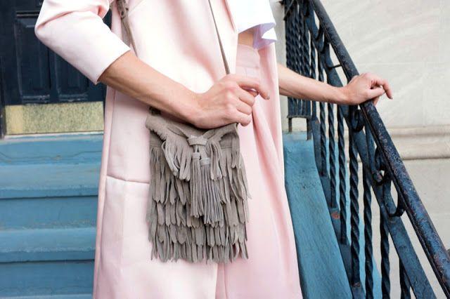 Zara suede fringe bag as seen here: https://bitly.com/shorten/