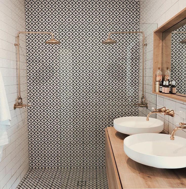 Beautiful patterned tiles are the focus of this bathroom teamed with off-white s