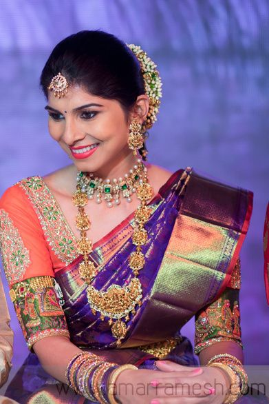 South Indian bride. Temple jewelry. Jhumkis.Purple silk kanchipuram sari with contrast blouse.Braid with fresh flowers. Tamil bride. Telugu bride. Kannada bride. Hindu bride. Malayalee bride. .South Indian wedding.