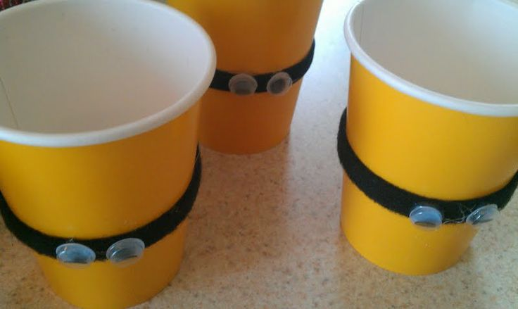 Despicable me party ideas- DUH! we can go cheap with yellow cups... tho I'd probably just go with a sharpie drawn on idea!