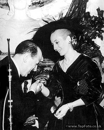 In a ceremony at the Gasa de Gobierno, Buenos Aires, Eva Peron, wife of the Argentine President, received an award of high distinction - granted by Syria for her extraordinary merits. The plenipotentiary Minister of Syria, Dr Zeki Djabi congratulates Mme Peron after the award. 23 April 1952