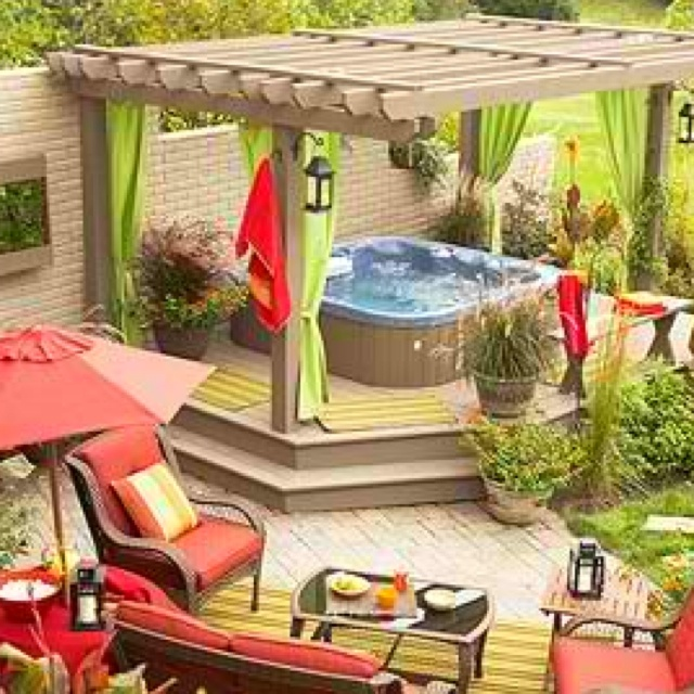 hot tub & pergola.. love the planters, lanterns and curtains....
