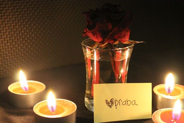 still life photography candle red rose