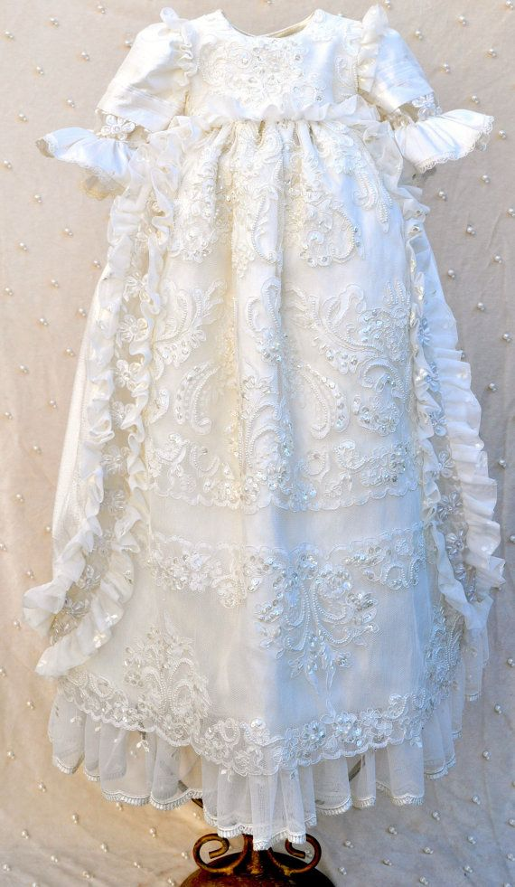 This extravagant silk christening gown is specially made for baptisms