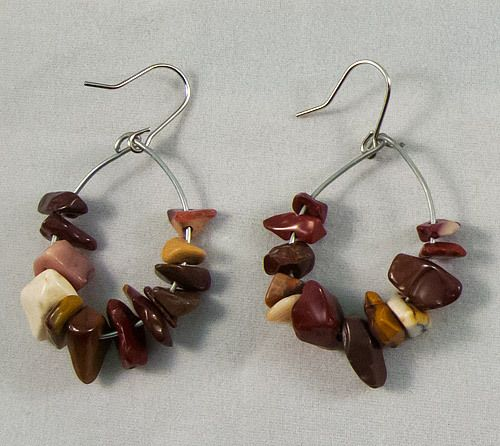 These are beautiful circular Yellow Opal mix earrings. They measure at 3 cm.