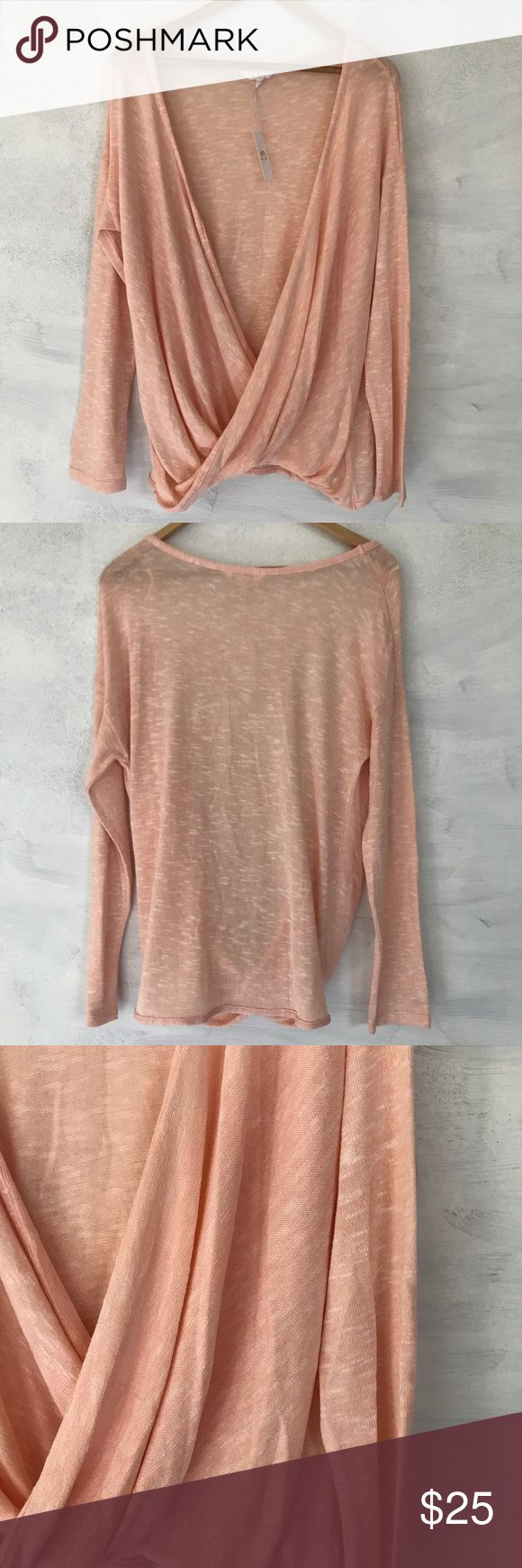 "Twist front top. Long sleeve twist front top. NWT. Light peach color. Size medium. Measures 19"" pit-to-pit and 25"" long. Sorry, no trades & I am unable to model. Tops"