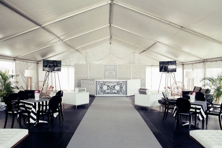 Marquee styled with black Louis Ghost chairs, Knoll lounges, Barcelona benches and ottomans. http://www.edeevents.com.au/marquees