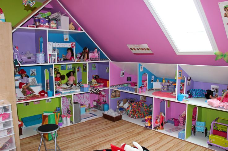 "The dollhouse for 18"" dolls built with MDF board. 8 ft. in height, 8 ft. wide, and 2 ft. deep. The side addition is 8 ft. in length, 48"" in height and 2 ft. deep, Her favorite Christmas gift ever."
