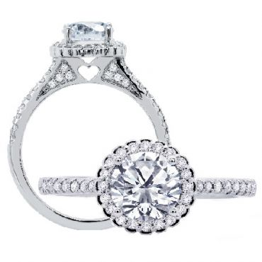 We love the peek-a-boo heart on the side profile of this gorgeous halo style engagement ring.  Peter Storm Jewelry