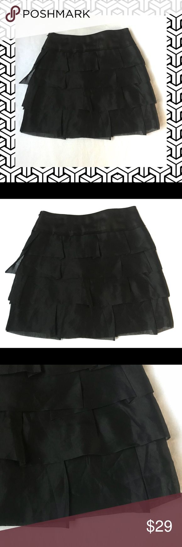"BCBG MAXAZRIA 4 Tiered Layered Ruffled Mini Skirt BCBG MAXAZRIA 4 Tiered Layered Ruffled Mini Skirt 100% Silk Sheer  Super cute skirt. Side zippered. Sheer layers over lining. Dry clean.  **** Marked 12 but the skirt was resized to fit a number 4. She did a great job. You can't tell that the skirt was resized. Please check all the measurents. *****   Waist (laying flat): 28""  Length: 17"" BCBGMaxAzria Skirts Mini"