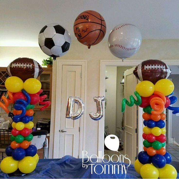Combine multiple sports for a all encompassing sports theme!  Football, soccer, basketball, and baseball balloons arch over these colorful balloon columns to create an arch for the birthday celebrant! | Balloons by Tommy | #balloonsbytommy