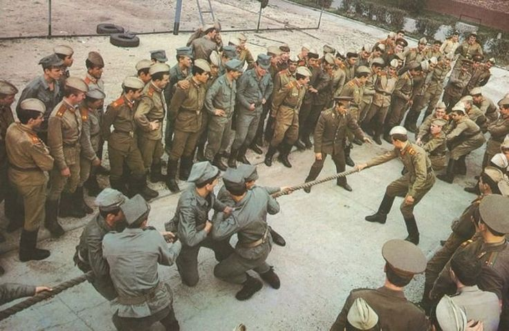 Polish Army and Soviet Army soldiers playing tug of war.