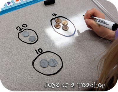 Sorting and counting coins in first grade. Great idea for getting students to see the money in sets to skip count.