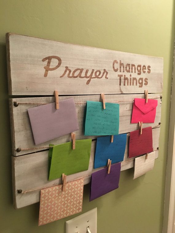 Handcrafted wooden Prayer Board is one of my favorite creations! What better way to keep track of all of your prayers than by pinning them and then watching to see how God answers them! This would be perfect in the hub of your home where it is a constant reminder of our many blessings! These also make wonderful gifts! Each board comes with 9 pins and metal wiring on the back so it is ready to hang upon arrival! Approximate Size: 24 X 16 inches If selecting white lettering, please include in…