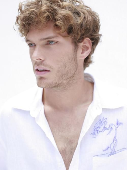 Good ol' Mihaly Martins.  He looks like Finnick to me, but he's a model not an actor, and he'd probably have to shave that beard.
