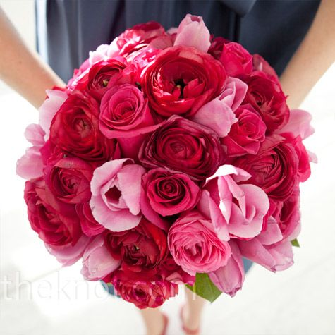 Lush and round bouquets of bright-pink roses popped against the bridesmaids' evening-blue dresses.