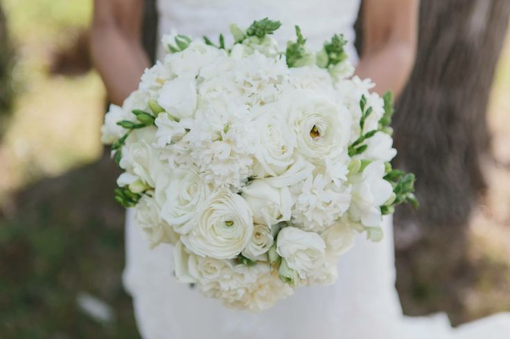 One of our recent brides bouquets using all white florals. Photography Shutter and Lace Photoraphy