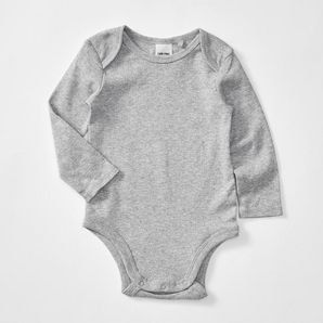 Make a sustainable choice with our baby bodysuit made form organically grown cotton.Pointelle knit.Envelope style neck.Snap stud closure at the crotch...