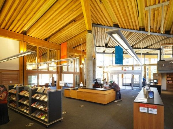 Inviting Library Design in Canada by Hughes Condon Marler Architects. Low shelving, open, lots of light.