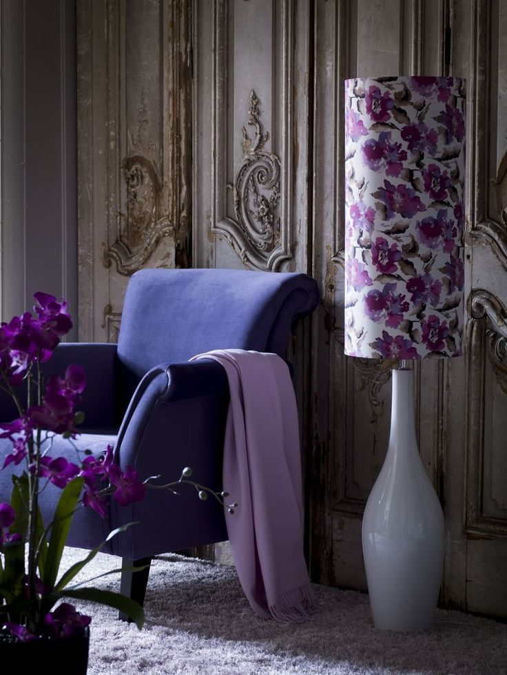 Living room and sitting room lighting ideas: Introduce a focal point by choosing a quirky floor light in the style of an oversized table lamp. This elegant new design comes with an on-trend, painterly, floral shade. It looks like an expensive designer buy but is excellent value for money. The pretty lilac and purple hues could inspire a scheme for a glamorous living room or bedroom. (Photo: Very). Find more ideas at housebeautiful.co.uk
