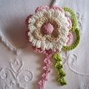 Brooch crochet fabric in three layers of colors: white, pink and beige.  This romantic brooch may look perfectly what both girls as mayores.Es perfect complement for a sweet summery and floaty...