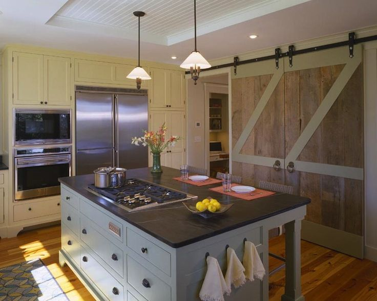 Oh for the love of all that is good and holy I simply must have barn doors in my kitchen one day!