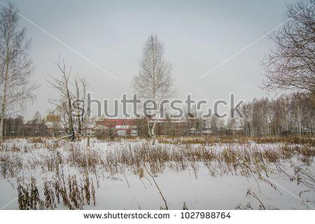 Vintage style red brick old factory, winter time landscape.
