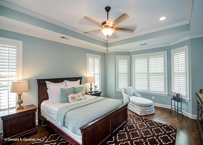 Master Suite With Bay Window And Tray Ceiling The