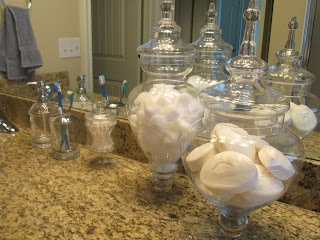 Pier 1 Apothecary Jars used for bathroom organization