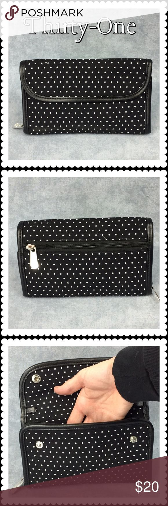 👜 Thirty One Every Wear Wallet (4095) 👜 Thirty One Every Wear Wallet 👜 Black with small white dots, one outer zip pocket, snap flap, inner one slide-in pocket, zippered compartment, one slide-in pocket, one zipper pocket, 8 card slots and an ID slot. In new and unused condition. Removable strap missing. Price reflects this. Thirty One Bags Wallets