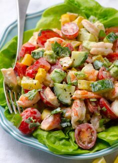 Greek Yogurt Shrimp, Avocado and Tomato Salad — Creamy shrimp salad with avocado, tomato, cucumber, bell pepper and scrumptious Greek yogurt dressing. You won't miss mayo for a second.