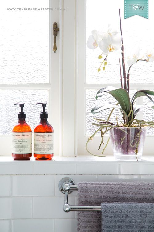 A sunny bathroom features tiles in lilacs & grey, an elegant faux orchid and eco-friendly Murchison-Hume products. We visit Temple & Webster member Jacoline at her Sydney home. Image - Maya Vidulich. Styling - Jessica Bellef. More on the Temple & Webster blog: http://blog.templeandwebster.com.au
