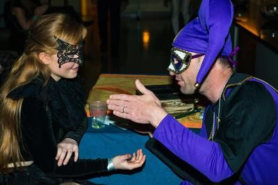 Reading Palms at a Masquerade Ball: Admitting to being a palmist can invite quizzical looks, as people often look at you like you are either an idiot or a charlatan. At least witches inspired