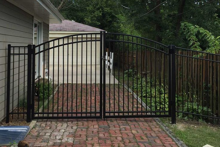 Photo Of Ultra Aluminum Arched Gate Across A Residential