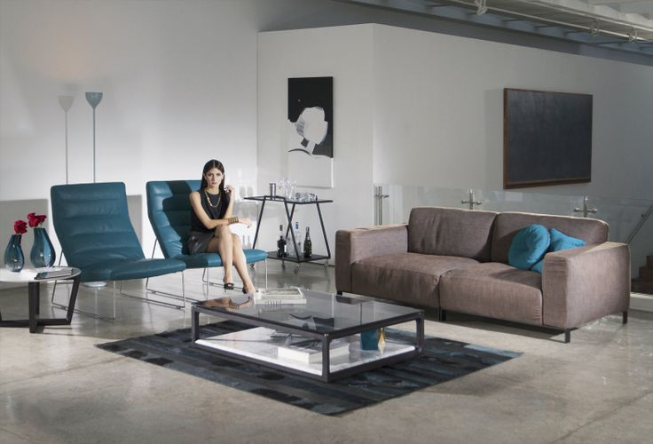 Pristine Sofa, upholstered in fabric Monaco Toffee, seat, back and armrest cushion in goose feathers, iron legs. Pristine living chair, upholstered in aniline leather Oil Blue, frame in stainless steel. Pristine coffe table, structure in Oak solid wood, top in glass and base marble.