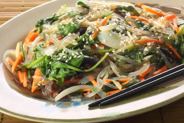 This simple noodle and vegetable dish is an easy way to disguise leftover vegetables (and even leftover chicken or meat) into a tasty meal. I like to use rice noodles in this recipe, but you can also use buckwheat noodles (memil gooksu, soba), cellophane noodles (sweet potato noodles, dangmyun) or even linguine or fettucine.