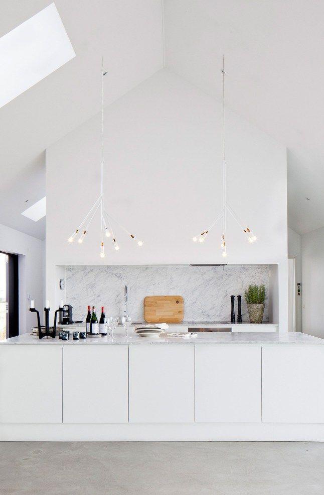 TheDailyMark.com.au kitchen island modern contemporary white sleek minimal hidden white loft attic apartment home