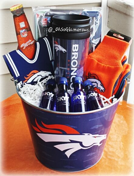 Broncos+Pail:  Tailgate+Pack(License+Plate+Frame,Decal,Sticker)  Skyy+Vodka+Shots  Broncos+Gloves  Gobbers+Candy  Broncos+Cup  Bottle+Jersey
